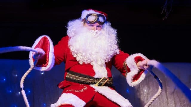 Jolly Christmas Postman Image - Photo from the show of Santa holding his sleigh reigns