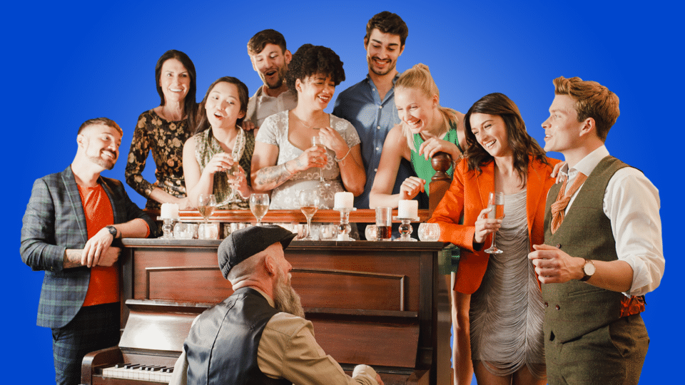 Family Sing-a-long - group of people singing round a piano on a blue background