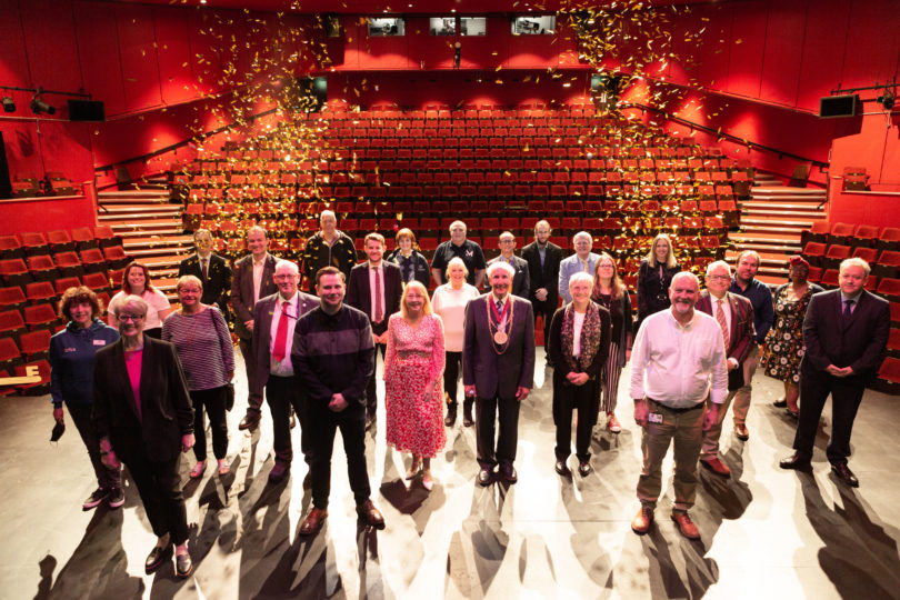 Confetti drop on the stage over leaders and funders